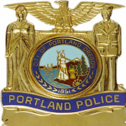 Portland police shot a man who was waving a gun at drivers on the I-84 freeway on Labor Day.